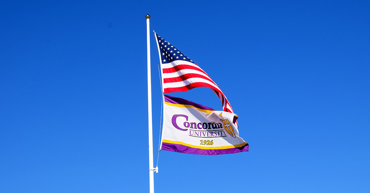 United States and Concordia University Texas flags on flagpole