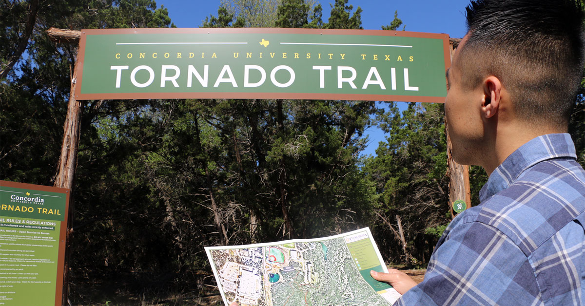 visitor with map at Tornado Trail entrance