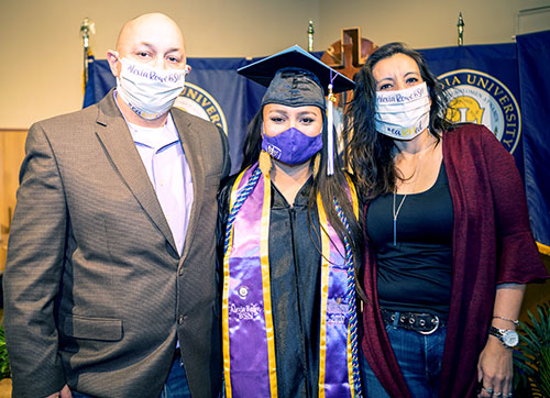 CTX parents with graduate at commencement